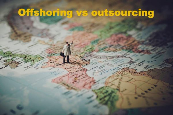Offshoring vs outsourcing: an illustration with a map and a figurine of a man standing on top of it